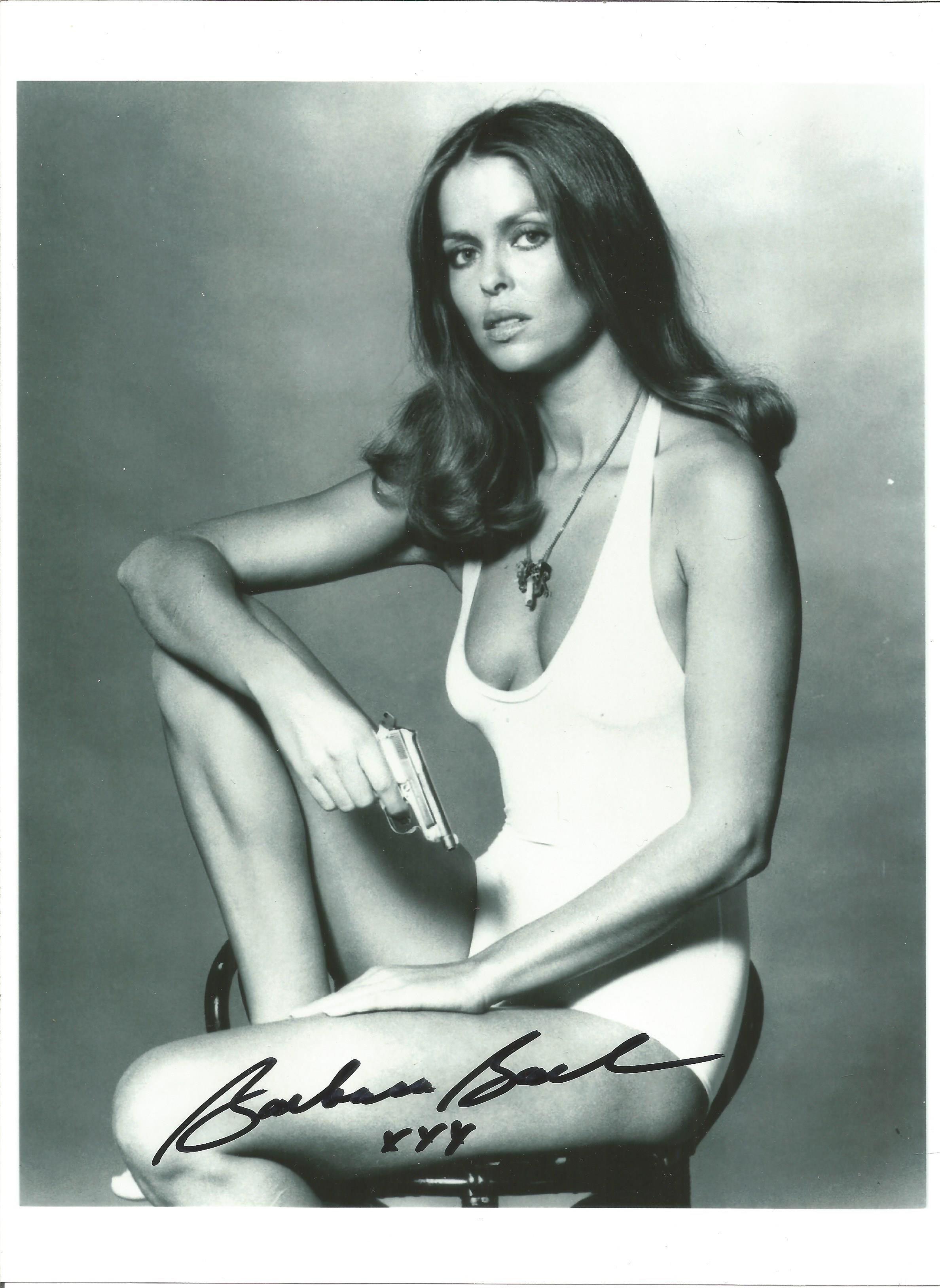 Barbara Bach signed 12x8 black and white photo. Good Condition. All autographs are genuine hand