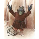 Warrick Davis as Waldi signed 10x8 colour photo. Good Condition. All autographs are genuine hand