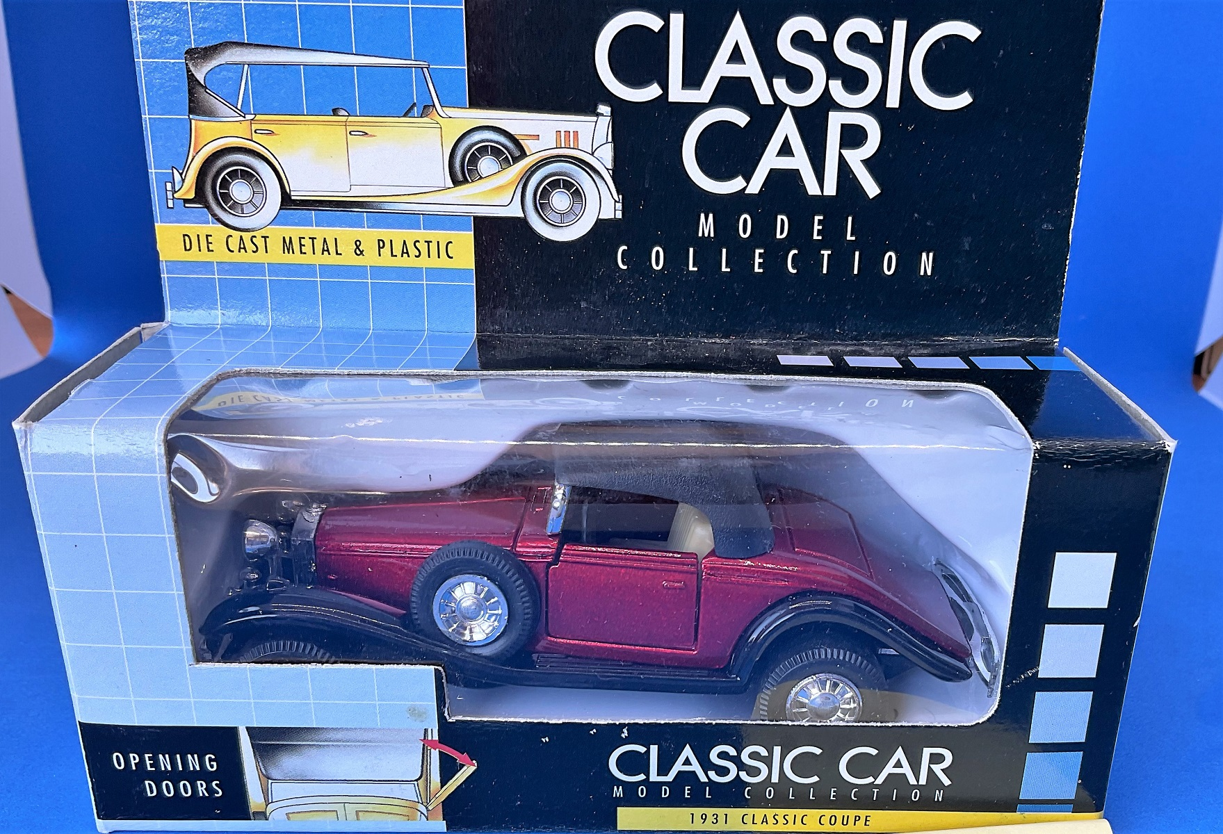 Vintage toys. A classic car model collector's item. A die-cast metal and plastic 1931 classic coupe,