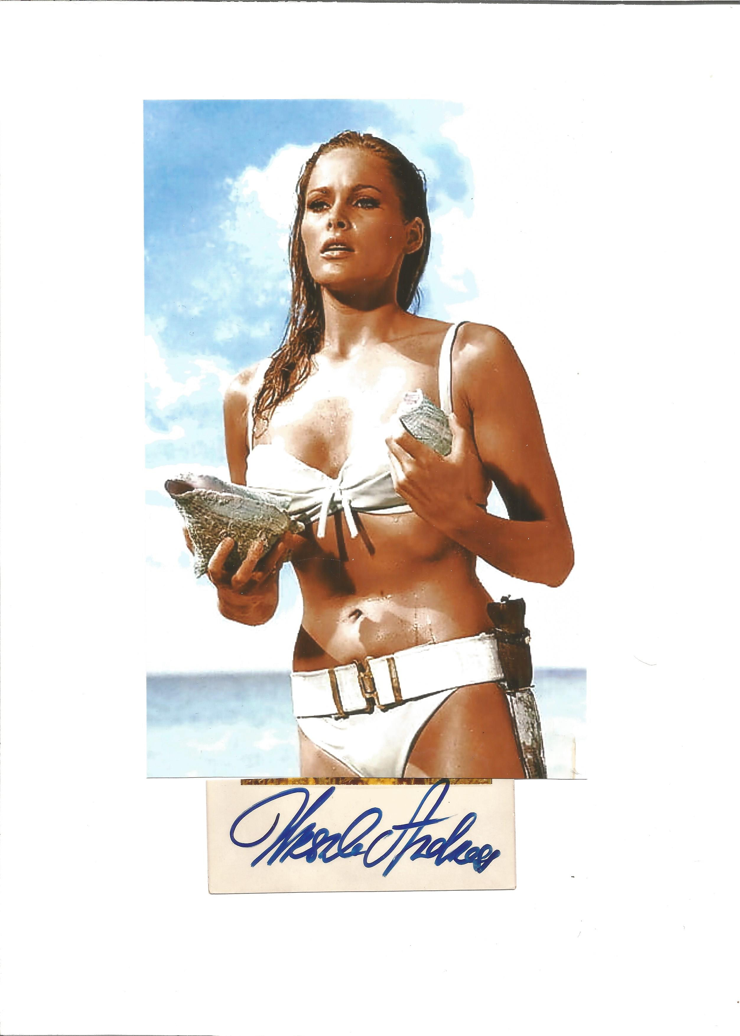 Ursula Andress signed signature card, attached to A4 card, with a 8x5 colour photo also attached.