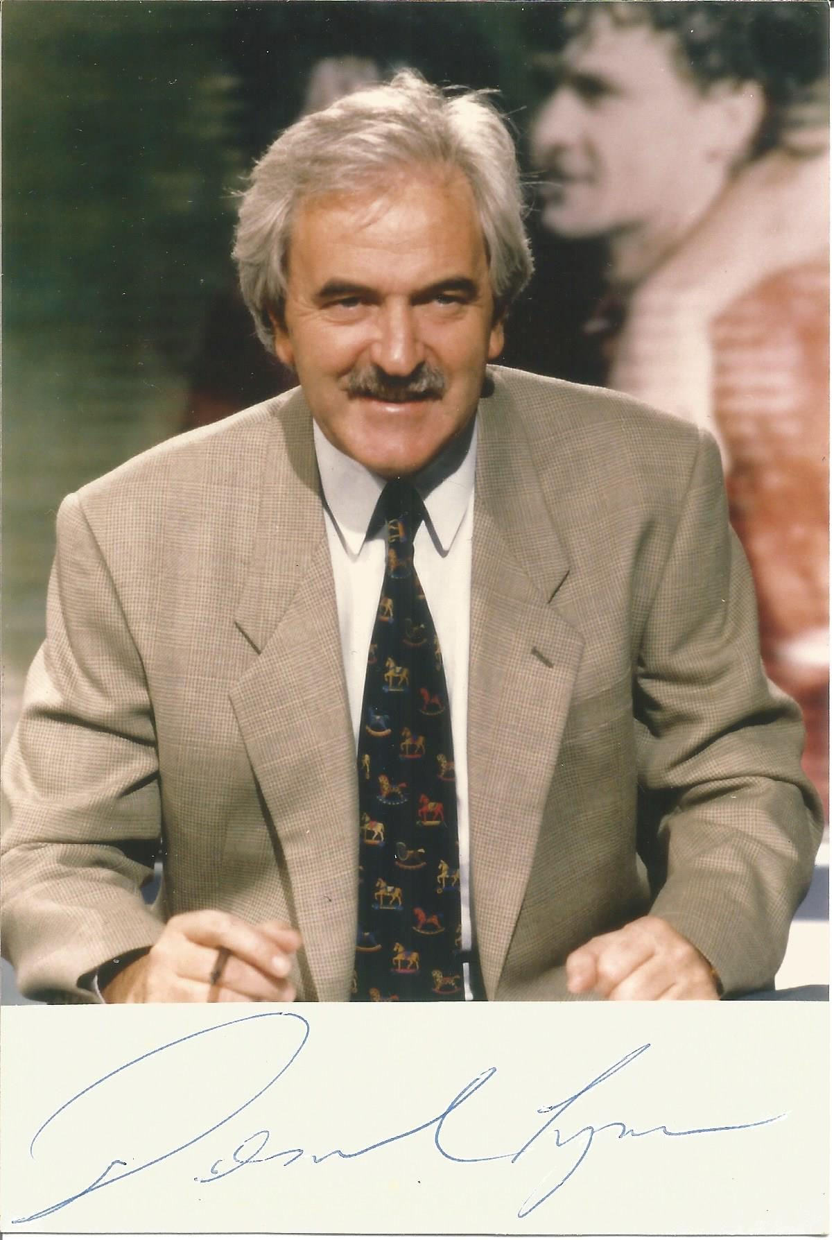 Des Lynam signed 6x4 colour photo. Desmond Michael Lynam, OBE (born 17 September 1942) is an Irish-