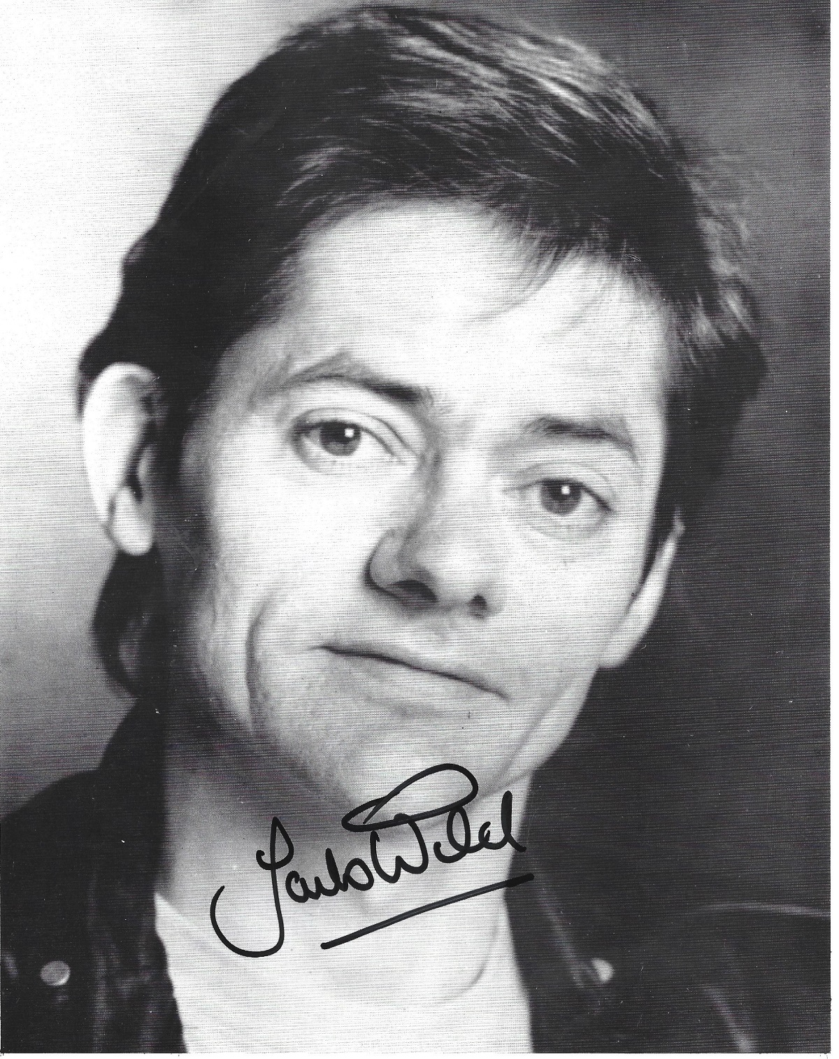 Jack Wild signed 10x8 black and white photo. Jack Wild (30 September 1952 - 1 March 2006) was an