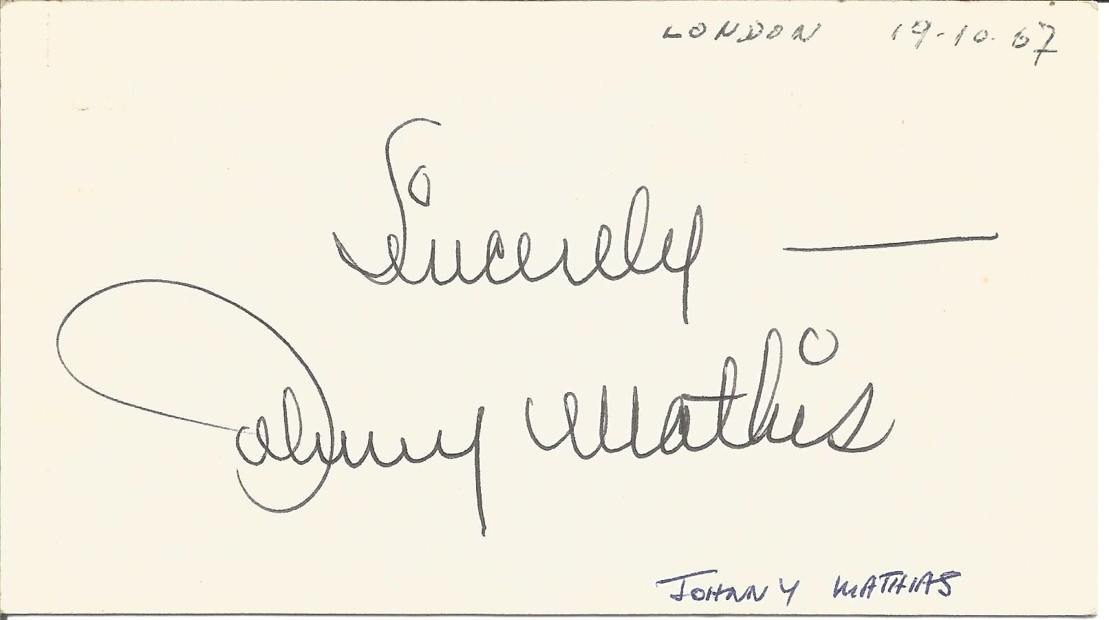 Johnny Mathis signed to clear back of vintage Mario and Francos Terrazza Restaurant 4 x 3 inch