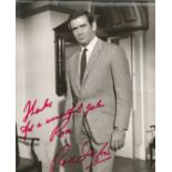Rod Taylor signed 10x8 black and white photo. Dedicated with a personal inscription, thanks for a