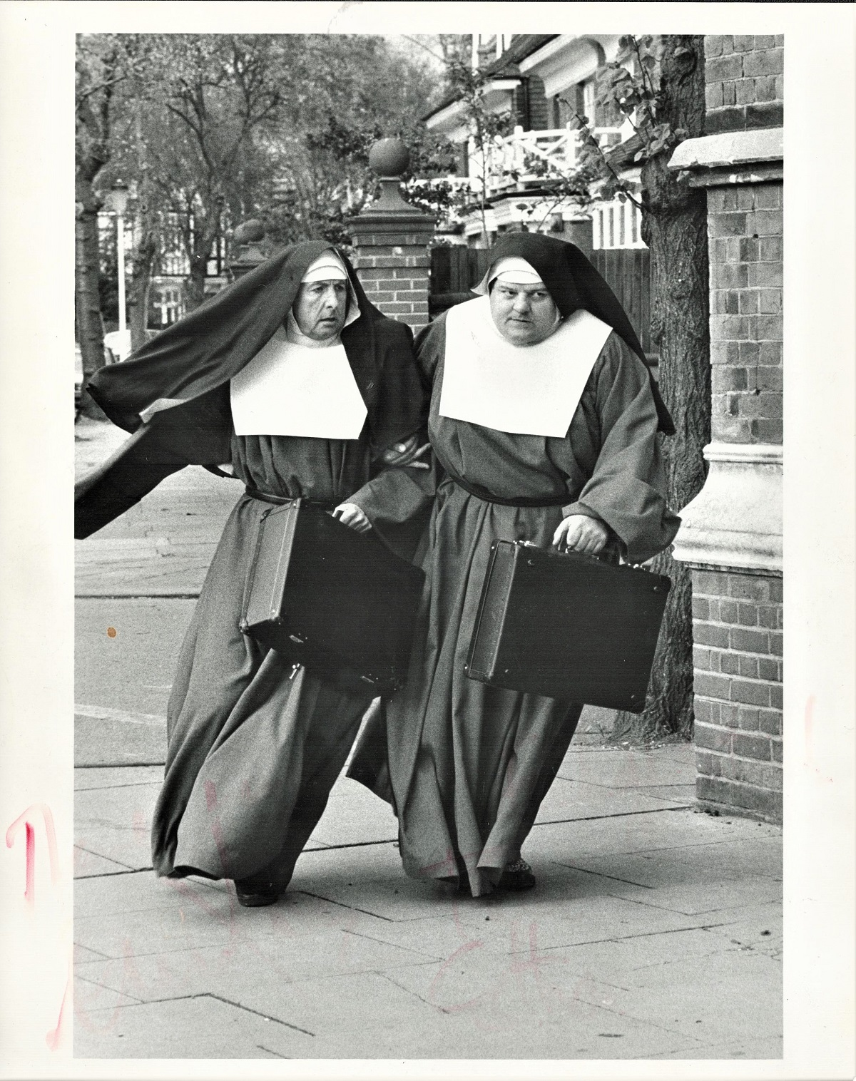Nuns on the Run 10x8 black and white photograph picturing Eric Idle and Robbie Coltrane. Signed by