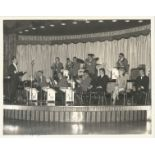 Johnny Howard signed and inscribed 10x8 black and white orchestra photograph. Good condition. All