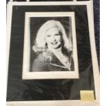 Ginger Rogers Signed 10x8 black and white photo mounted to an overall size of 17x15.