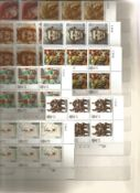 GB Stamps £56+ face value used & Mint Stamp Album containing 14 Hardback pages with 7 rows on each