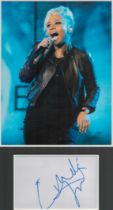 Emeli Sande signature piece in autograph presentation. Mounted with photograph to approx. 16 x 12