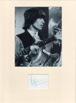 Bill Wyman signature piece in autograph presentation. Mounted with photograph to approx. 16 x 12