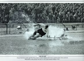 Football, Tom Finney signed 12x18 black and white photograph picturing the iconic Splash Down as