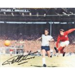 Football. Geoff Hurst Signed 10x8 colour photo. Photo shows the Hurst Shooting for goal against West
