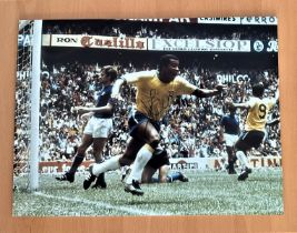 Football, Jairzinho signed 12x16 colour photograph pictured in action whilst playing for Brazil in