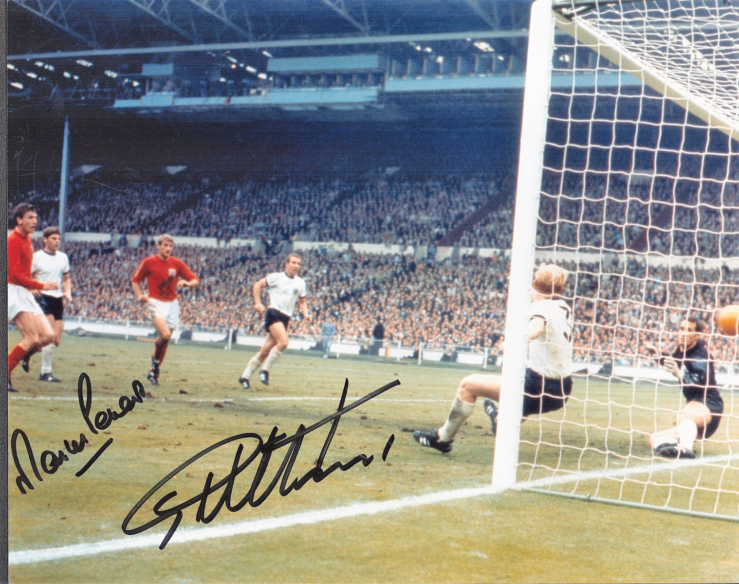 Football. Martin Peters and Geoff Hurst Signed 10x8 colour photo. Photo shows the pair in action