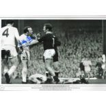 Football. Nobby Stiles Signed 18x12 black and white photo. Photo shows Stiles picking a fight with