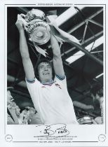 Football. Billy Bonds Signed 16x12 black and white photo with claret and blue around edges of shirt.