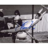 Nadia Comaneci, wonderful 8x10 photo signed by legendary Olympic gymnast Nadia Comaneci. Good