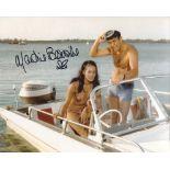 007 Bond girl Martine Beswick signed 8x10 Thunderball scene photo. Good condition. All autographs