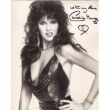 007 Bond girl Caroline Munro signed sexy 8x10 photo. Good condition. All autographs come with a