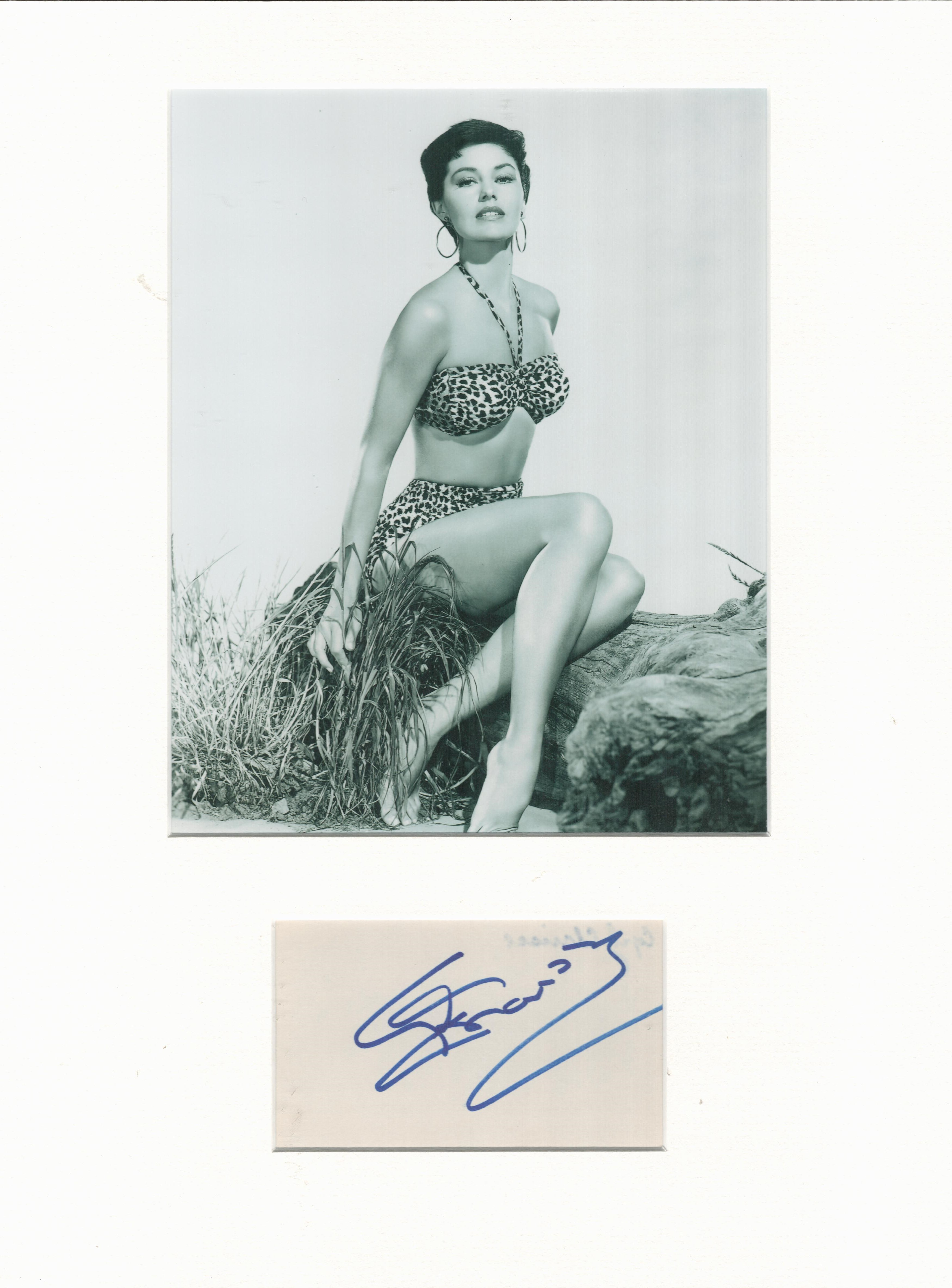 Cyd Charisse mounted autograph presentation. Signature mounted with unsigned photo to an overall