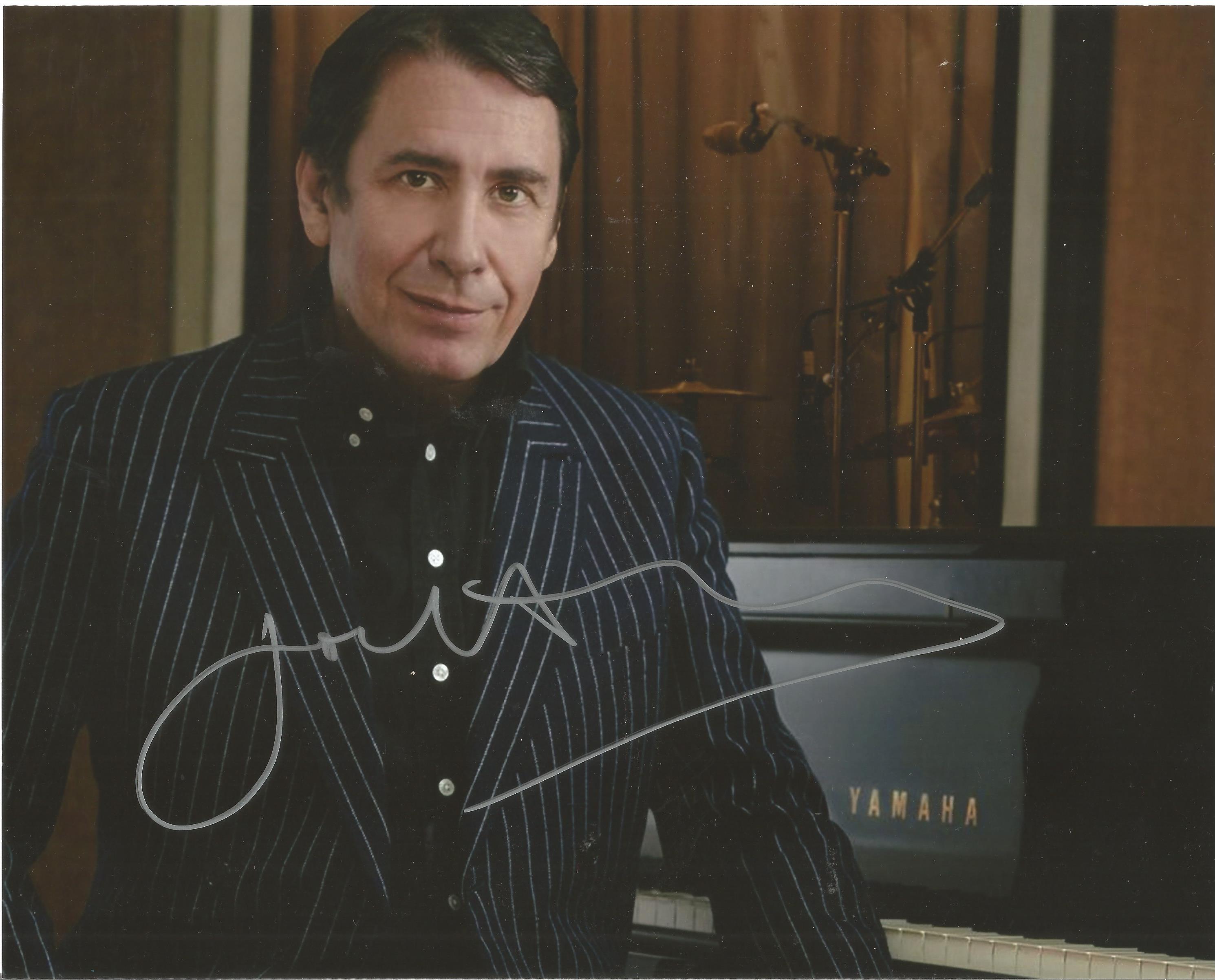 Jools Holland signed 10x8 colour photo. Photo shows Holland next to a Yamaha Piano. Julian Miles