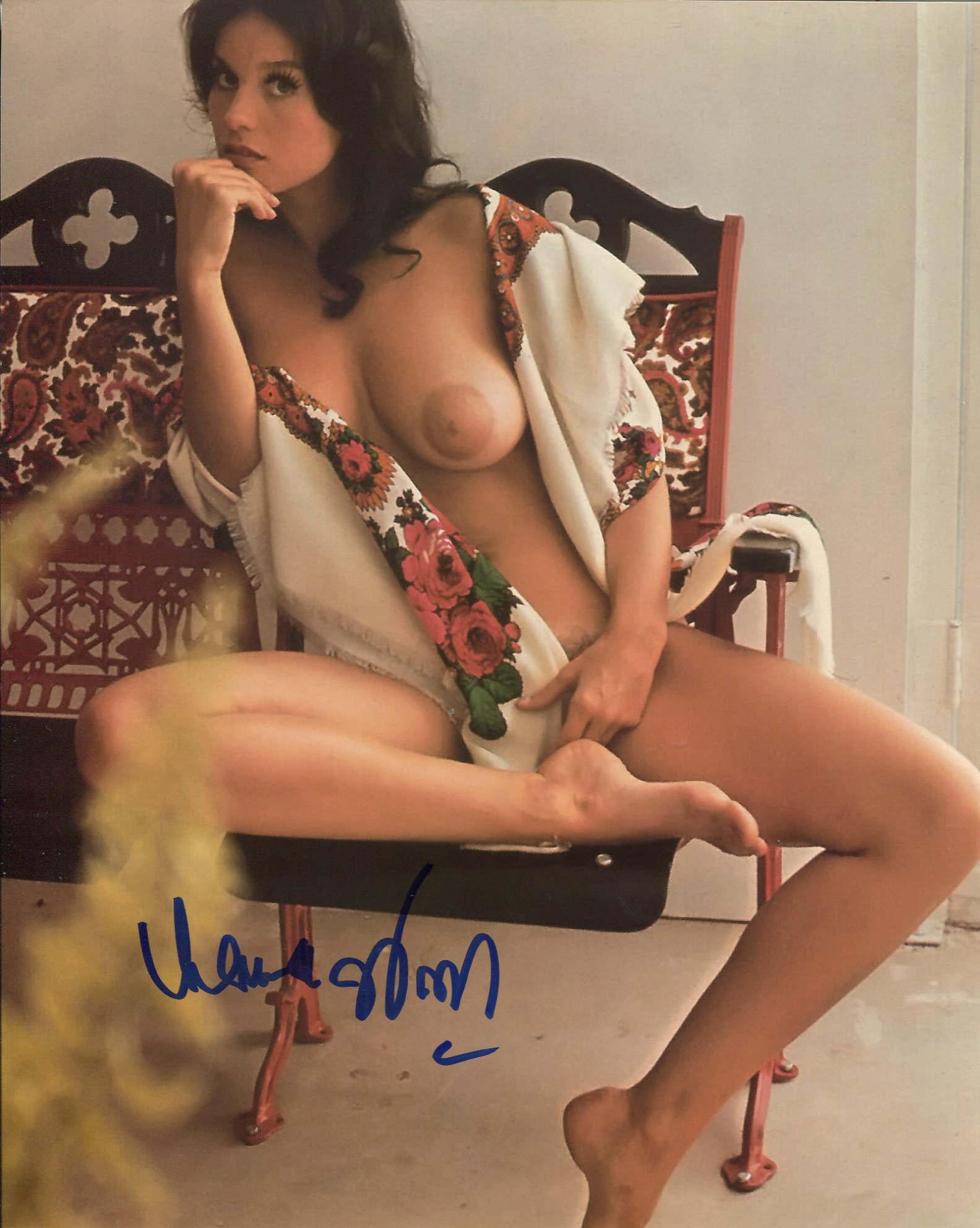 007 Bond girl Lana Wood signed photo, desirable image of her reclining topless in a chair. Good
