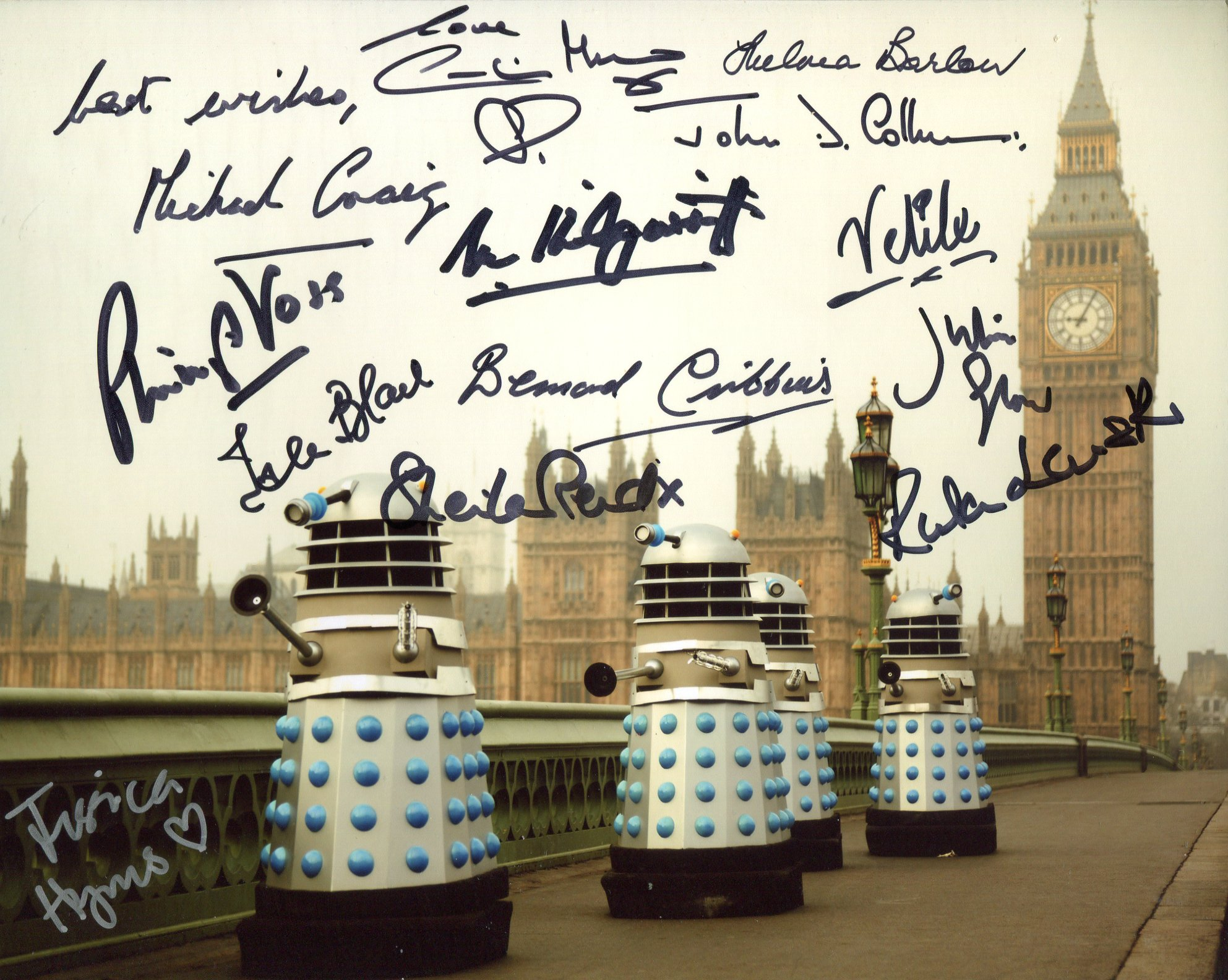 Doctor Who 8x10 Daleks in London photo signed by 13 actors who starred in the series, these are