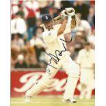 Cricket. Michael Vaughn Signed 10x8 colour photo. Photo shows Vaughn as a batsman in action for
