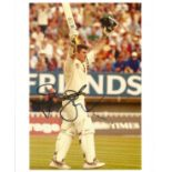 Cricket. Graeme Smith signed 10x8 colour photo. Photo shows Smith Celebrating a Century during a