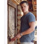 Matt Damon 8x10 photo from the thriller movie The Bourne Identity signed by actor Matt Damon. Good