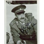 007 James Bond movie photo signed by actor John Bowe as Colonel Feyador. Good condition. All