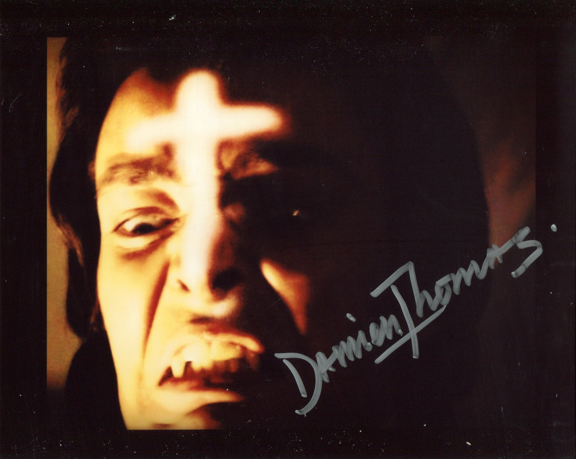 Twins of Evil horror movie photo signed by actor Damien Thomas. Good condition. All autographs