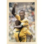 Football. Pele Signed 33x23 Colour printed photo. Photo, Matted. Photo shows Pele being lifted in