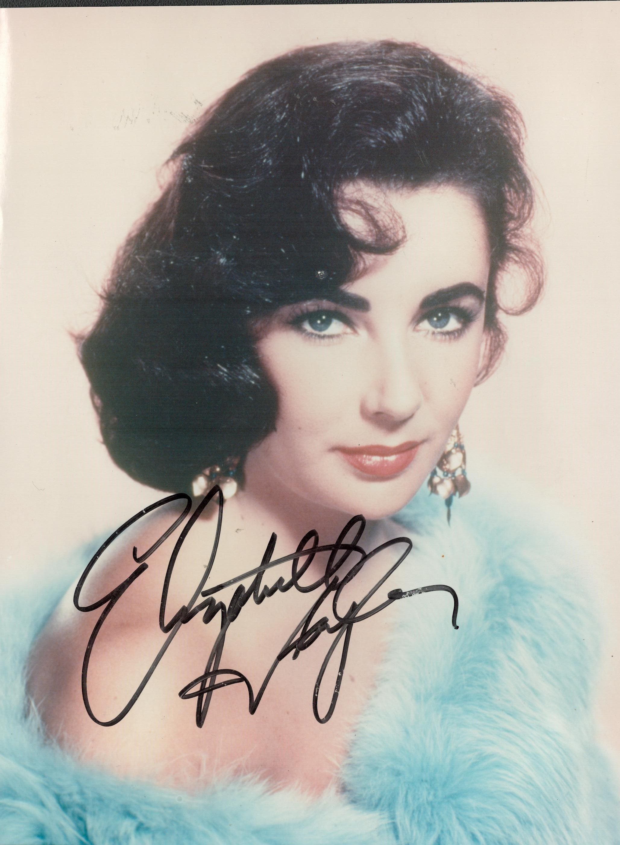 ELIZABETH TAYLOR (1932-2011) Actress signed 8x10 Photo . Good condition. All autographs come with
