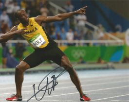 Usain Bolt signed 12 x 8 inch Athletics photo in classic pointing pose.