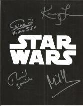 Star Wars photo signed by four actors inc Richard Stride, Kamey Lau, Michael Henbury.