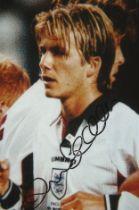 David Beckham signed 6x4 colour England photo. English former professional footballer, the current