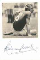 Bobby Moore signature on card below black and white newspaper photo. Overall size approx 6x4. 12