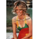 Farrah Fawcett signed 6x4 colour photo. Good condition. All autographs come with a Certificate of