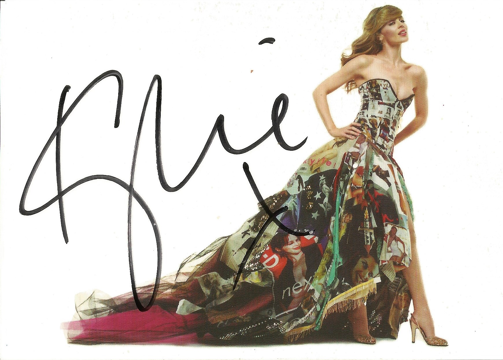Kylie signed 6x4 colour postcard photo. Good condition. All autographs come with a Certificate of