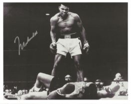 Muhammad Ali signed 10 x 8 inch b/w boxing photo standing over Sonny Liston