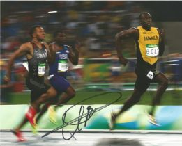 Athletics Usain Bolt signed 10 x 8 inch colour photo in action.