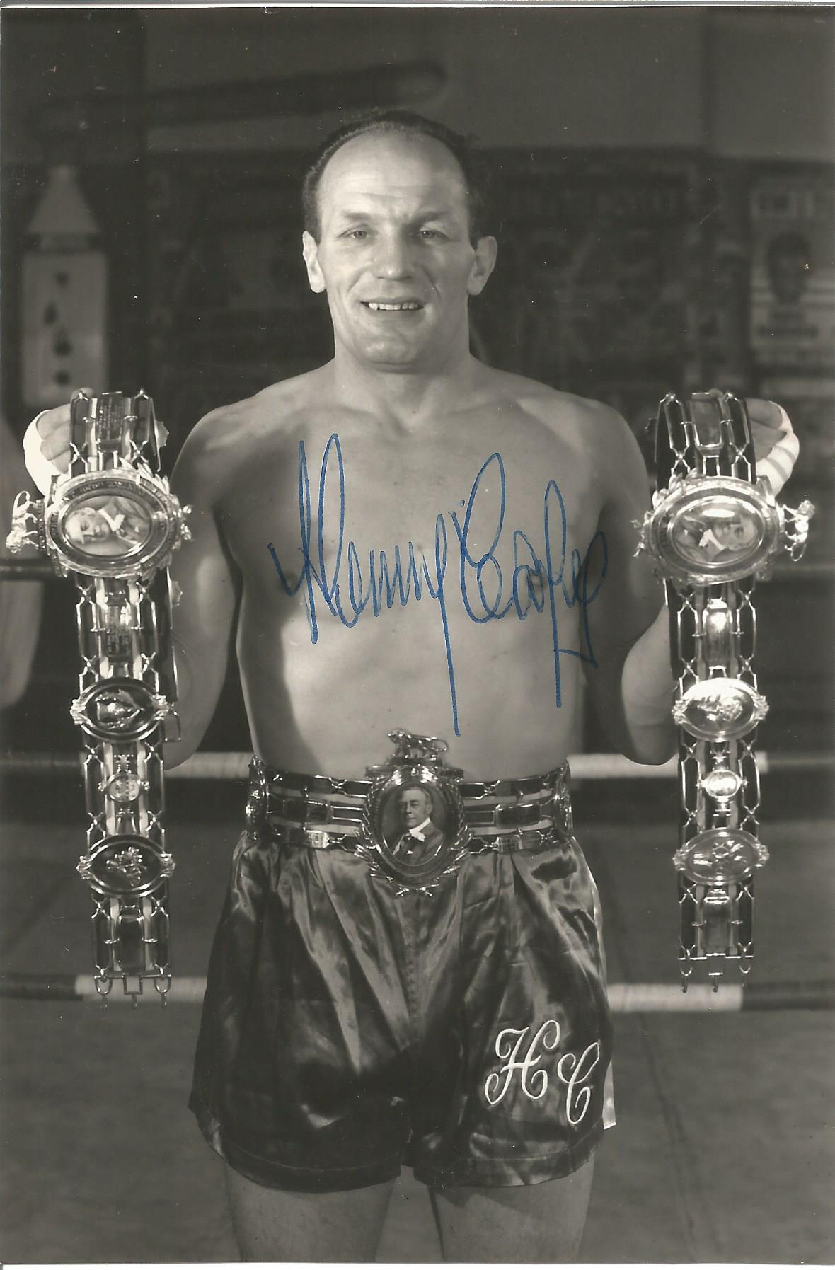 Boxer Henry Cooper signed 6x4 original black and white photo showing Cooper wearing his Lonsdale