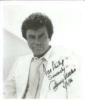 Singer Johnny Mathis signed 10x8 black and white image, dedicated to Philip. John Royce Mathis is an