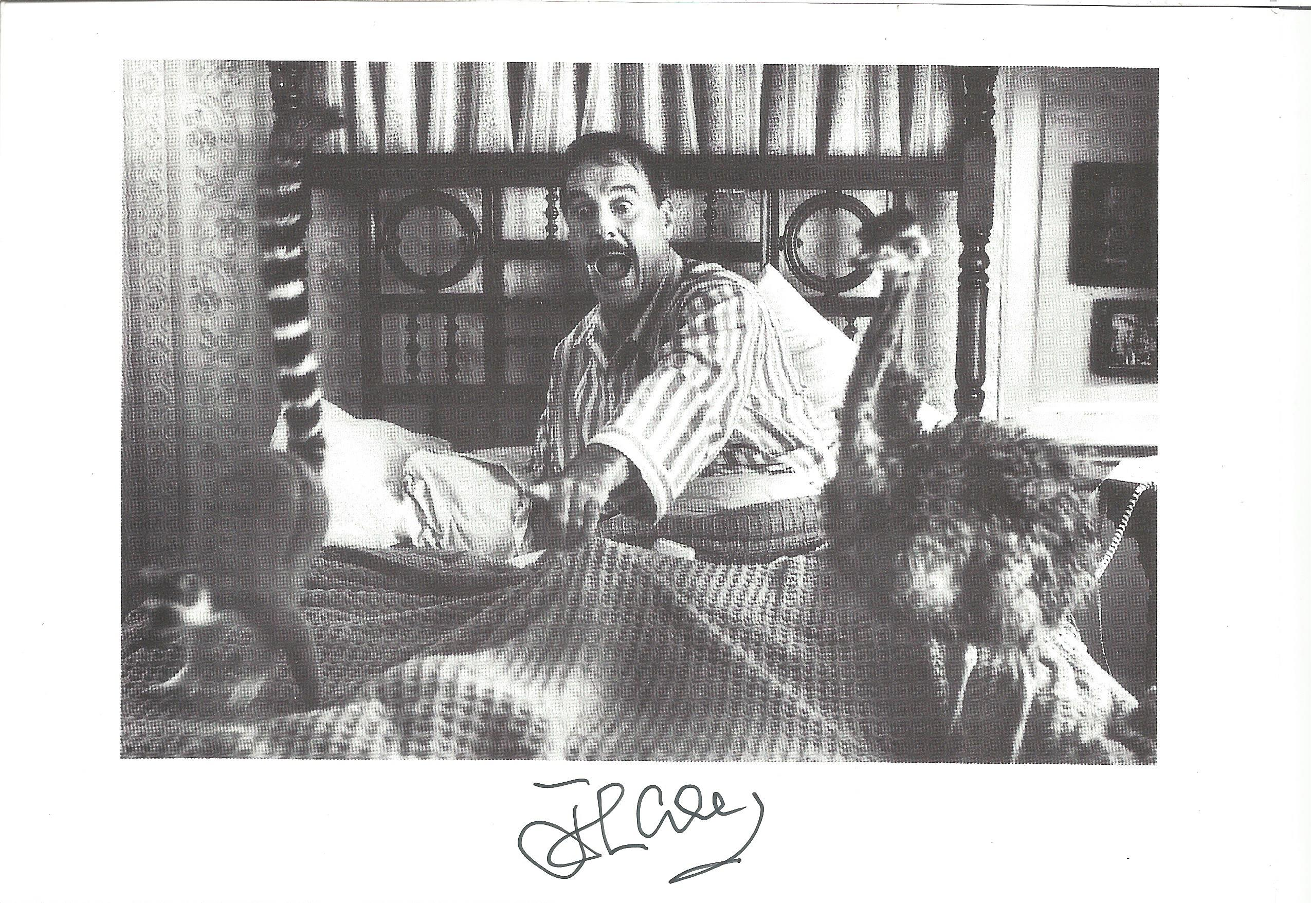 Actor and Comedian John Cleese signed 8x6 black and white photo from the 1997 film Fierce Creatures.