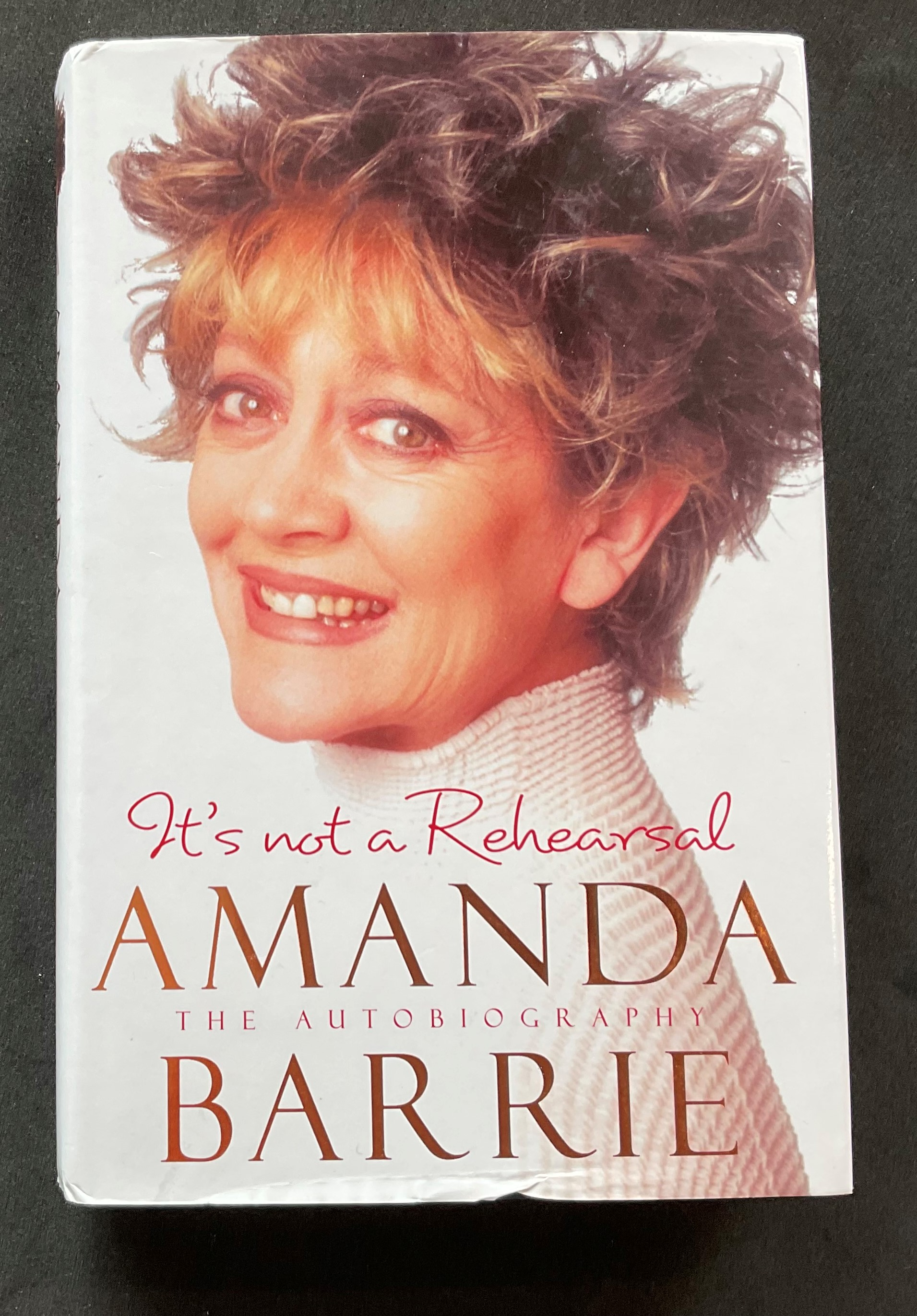 Actress Amanda Barrie's autobiography Its Not a Rehearsal, with nice inscription on the title page
