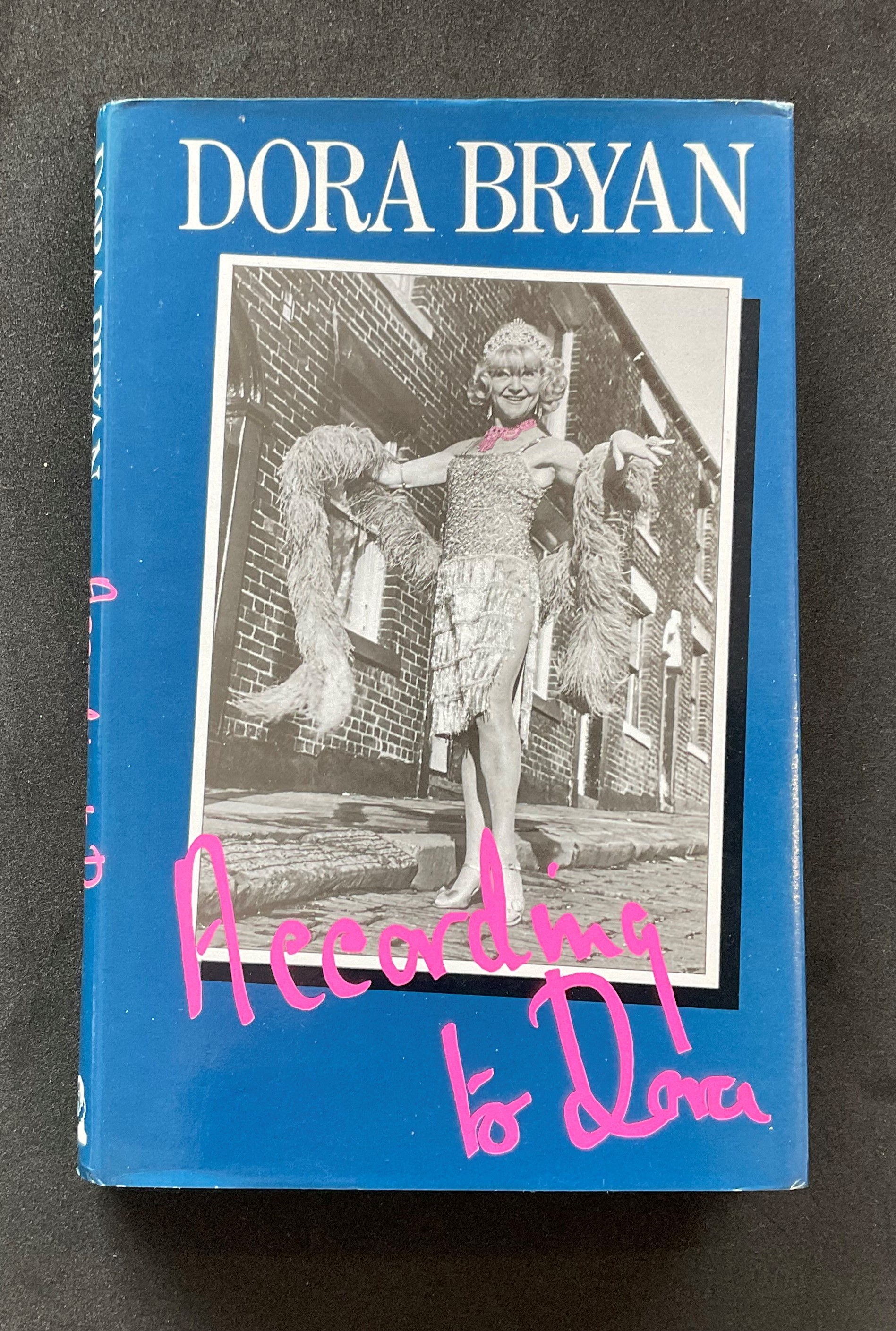 Actress Dora Bryans autobiography According to Dora, with nice inscription on the first page