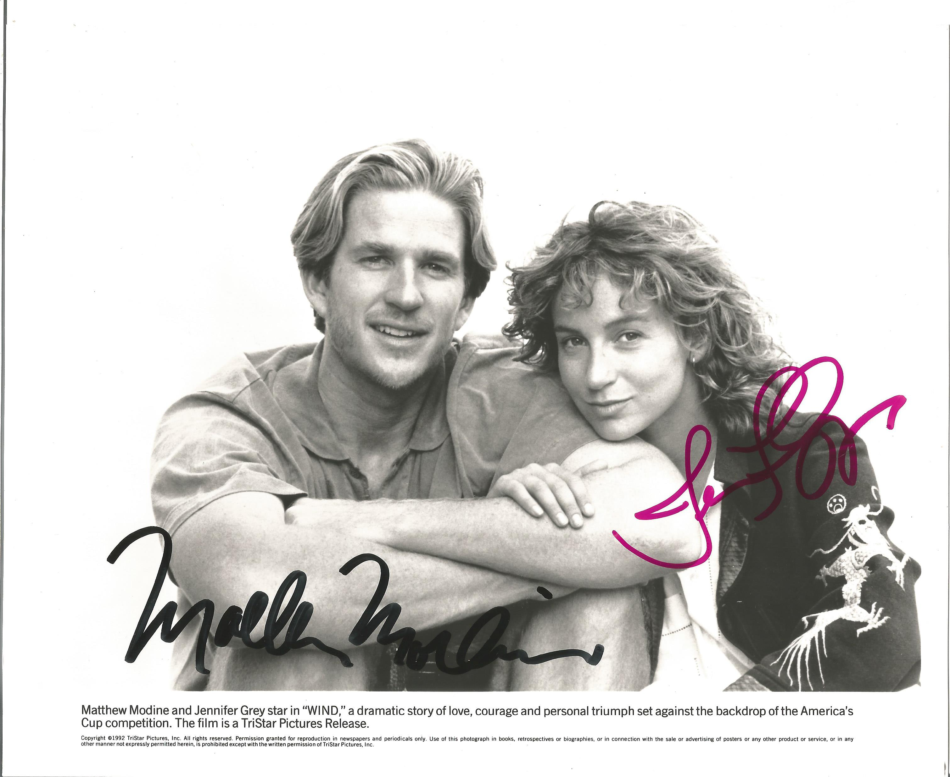Actor Matthew Modine and Actress Jennifer Grey signed 10x8 black and white promotional image from