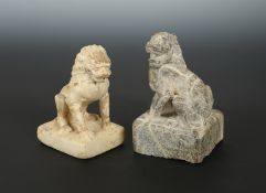 A Chinese carved white marble seated lion, in Sui Dynasty style, 13.5cm, another, larger, in
