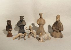 A Group of seven Chinese pottery tomb figures, of diverse type including dancers and entertainers,